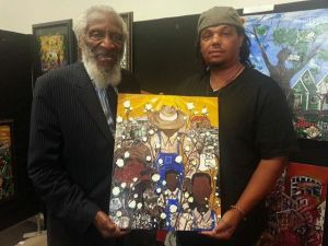 "Bryant with Dick Gregory holding ""UNDER THE SUN"""