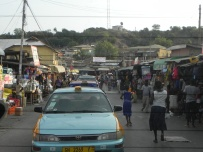 Stores are roadside and packed with shoppers.
