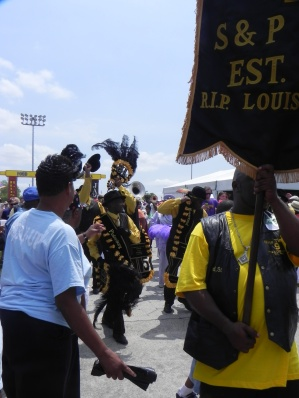 2nd Line rollin thru Jazz Fest crowds