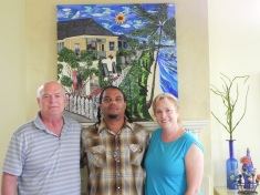 Commission for Bob & Alison Borrison standing in front of their commissioned piece.