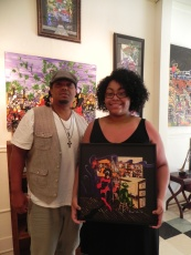 Taylor Simien with her framed print of Piano Jazz Man