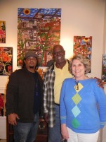 """Charles & Therese Asher are standing in front of their 2 new originals, """"Nature's Takin Ova"""" and """"Green Architecture"""". This collection hangs in Indiana."""