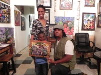 Shelly & Malachi Alexander with their new piece of Benoit Gallery art.