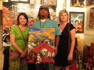Kendra Pearson & friend pictured with her Benoit Gallery artwork, When The Saints Go Marching In.