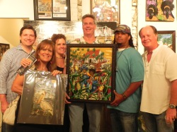 Our Sugar Mill Pond Friends, from Sugar Mill Pond Realty. Paul & Dawn Quick with their peice, Sharing Sugar Cane. Glenda Bryan & husband with their new Fly Lil Pelican matted print.