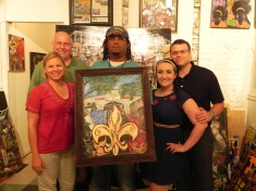 John Pere & family with their new painting, The Hamilton Club.