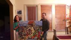 """Teresa Green & Van Coussan with """"Harvesting"""". They have 2 Bryant Benoit originals in their collection."""