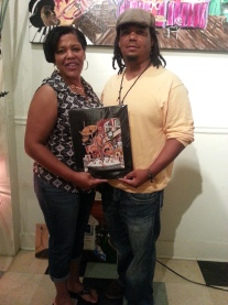 Erica with her new Saints Superbowl print.